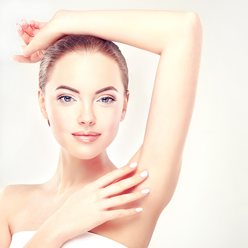 Armpit epilation, lacer hair removal. Young woman holding her ar